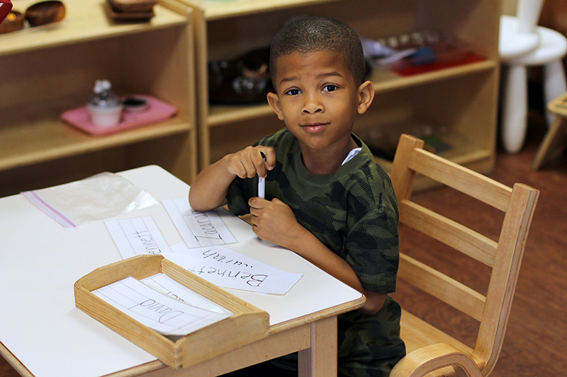 santan charter school learn happy kid at desk